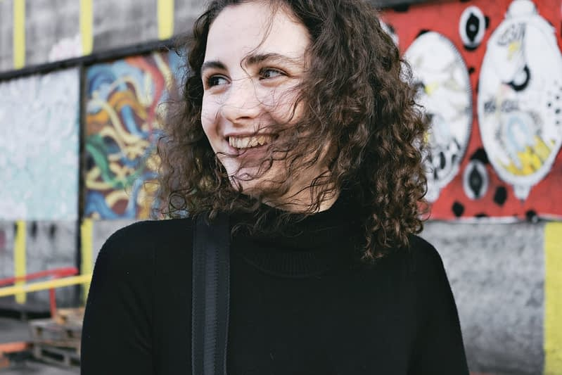 girl smiling with permed hair