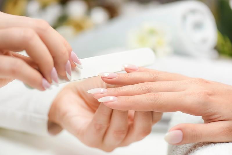 filing nails at a salon