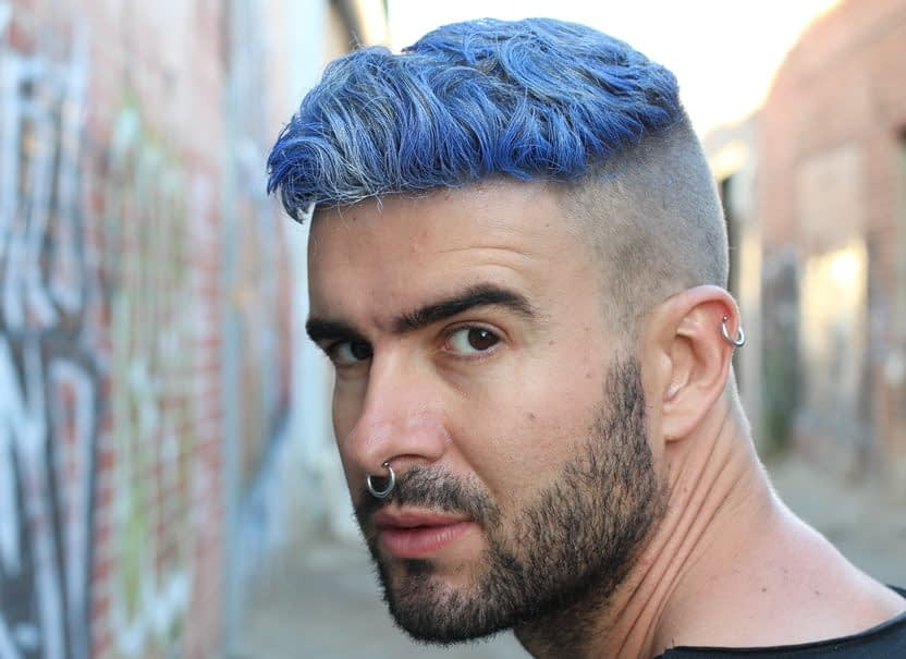 Model with colored hair looking toward camera