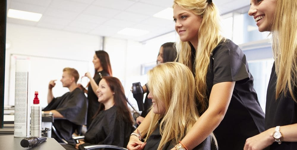 beauty school students working in the salon