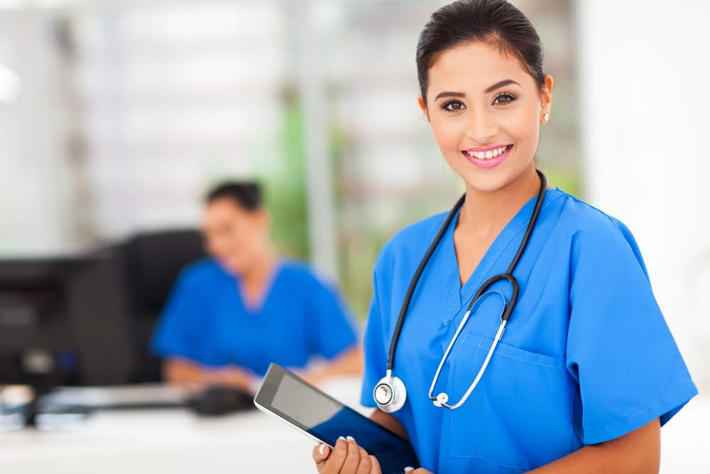 nurse in blue scrubs