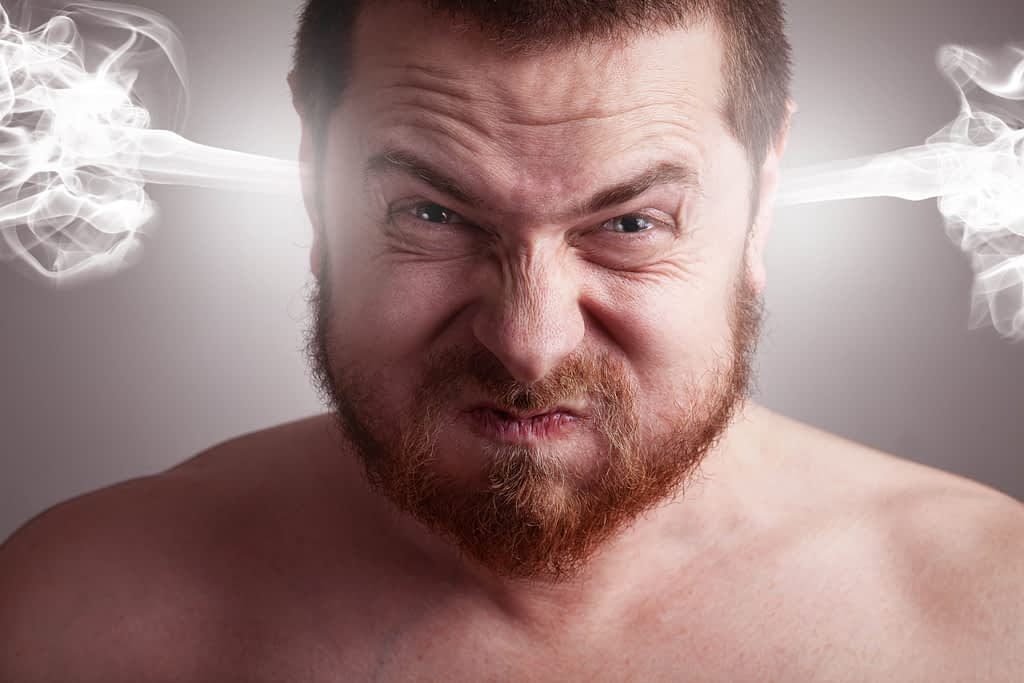 Man with angry expression and steam blowing out of his ears