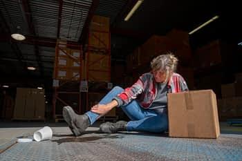 Warehouse employee injured after slipping