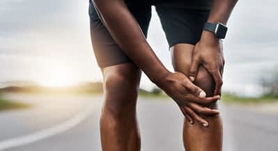 Athlete Holds Hurting Knee