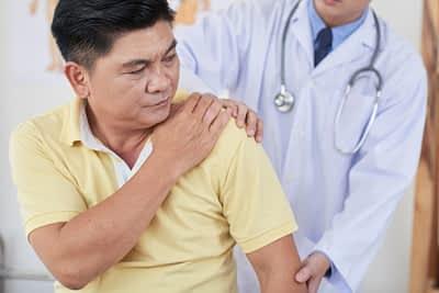 Doctor Examines Patient Shoulder Injury