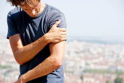 Man experiencing pain in upper arm