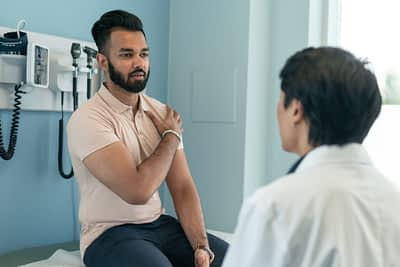 Patient consults with doctor