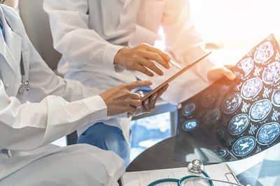 Surgeons examine brain X-rays