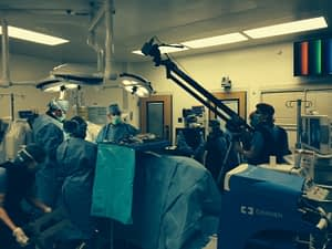 Dr. Adam Lipson and his team performing surgery live.