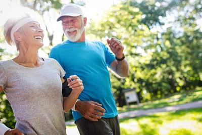 Mature couple jogging outside